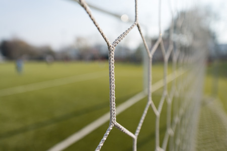 White Soccer or Football Net With Blurred Field Background