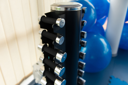 Stand With Dumbbells in Gym