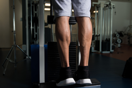 Bodybuilders Legs Shot Close Up In A Gym In Workout