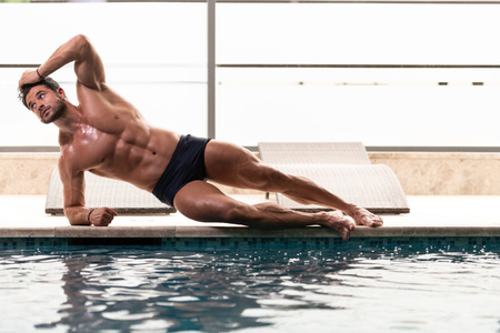 Fashion Portrait Of A Very Muscular Sexy Man In Underwear At Swimming Pool Stock Photo