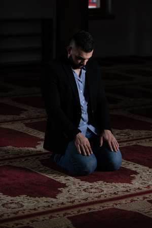 Businessman Muslim Making Traditional Prayer to God Allah in the Mosque