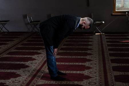 Attractive Man Making Traditional Prayer to God Allah in the Mosque