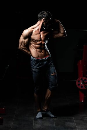 Portrait Of A Adult Physically Fit Man Showing His Well Trained Body - Muscular Athletic Bodybuilder Fitness Model Posing After Exercises