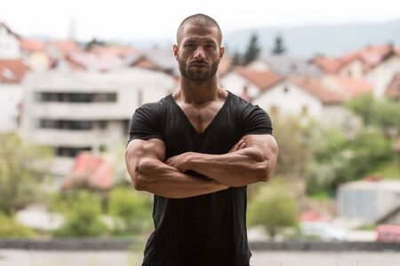 Portrait of a Young Physically Fit Man Showing His Well Trained Body - Muscular Athletic Bodybuilder Fitness Model Posing After Exercises Outdoors