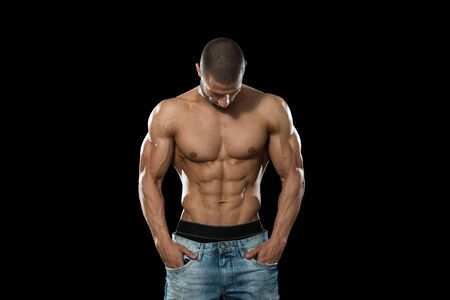 Muscular Young Man Posing In Studio - Isolated On Black Background Stock Photo