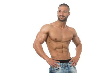 Muscular Young Man Posing In Studio - Isolated On White Background