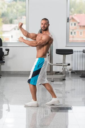 Portrait Of A Young Physically Fit Man Showing His Well Trained Body - Muscular Athletic Bodybuilder Fitness Model Posing After Exercises Stock fotó