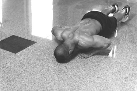 Young Model Doing Push Ups As Part Of Bodybuilding Training