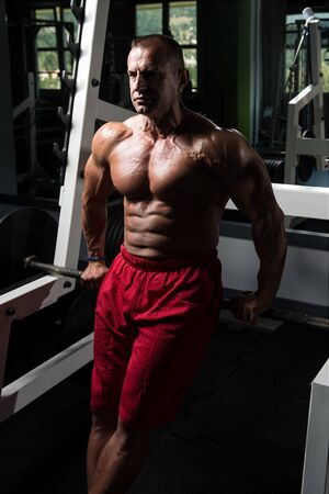 Handsome Good Looking And Attractive Mature Man With Muscular Body Relaxing In Gym