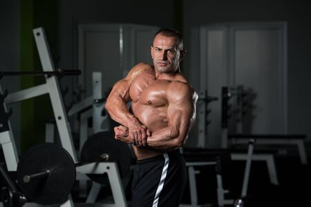 Portrait Of A Mature Physically Fit Man Showing His Well Trained Body - Muscular Athletic Bodybuilder Fitness Male Posing After Exercises