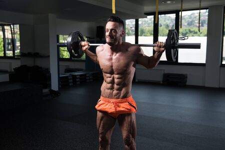 Strong Man In The Gym Exercising Quadriceps And Glutes With Barbell - Muscular Athletic Bodybuilder Fitness Model Exercise