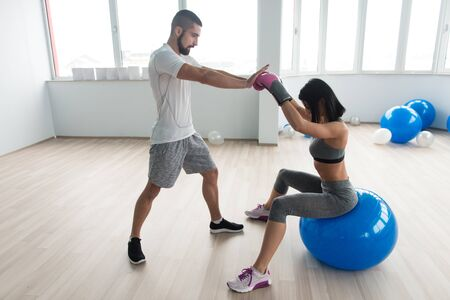 Woman Boxer MMA Fighter Practice Her Skills With Personal Trainer In Gym