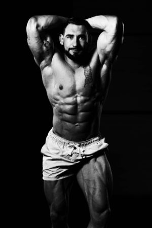 Portrait Of A Young Physically Fit Man Showing His Well Trained Body - Muscular Athletic Bodybuilder Fitness Model Posing After Exercises Imagens