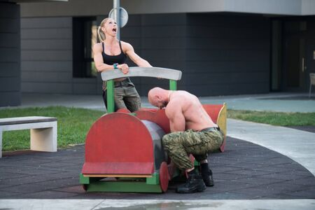 Sporty Fit Couple Playing Around Outdoors Afther Exercise In Gyma