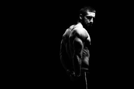Young Bodybuilder Flexing Muscles - Isolate on Black Blackground - Copy Space