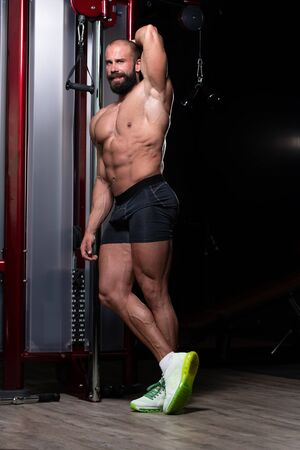 Man Exercise Workout in Gym Fitness Breaking Relax Holding Healthy Lifestyle Bodybuilding