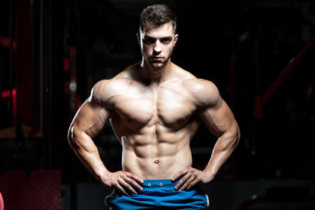 Portrait Of A Young Physically Fit Man Showing His Well Trained Body - Muscular Athletic Bodybuilder Fitness Model Posing After Exercises Banco de Imagens