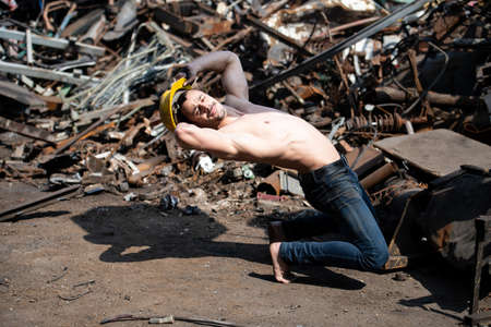 Handsome Man Keeping Balance on Hands in Old Industrial Junk Yard - Muscular Athletic Bodybuilder Fitness Model