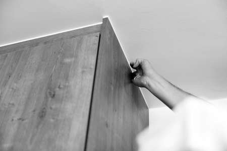 Construction Worker Use Finger Applying Silicone for Repairing and Installing Kitchen in House