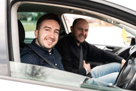 Driving Instructor and Man Student in Examination Car Testing Learner Driver