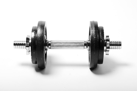 Dumbbell with four steel pancakes on a white background photo