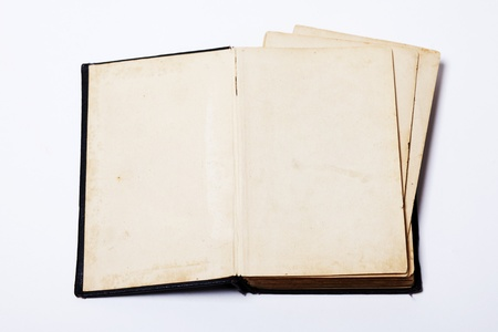 Open old map book on white background photo