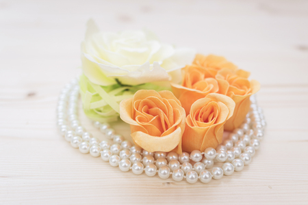baroque pearl: flowers and pearls composition on a wood background