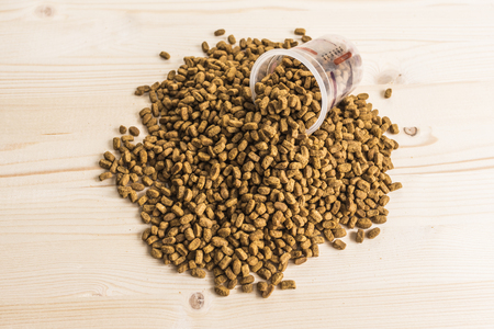 granule: Dry pet nutrition with a measuring cup top view
