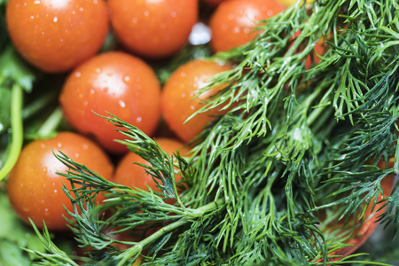 country kitchen: 7 Cherry tomatoes with parsley and dill close up