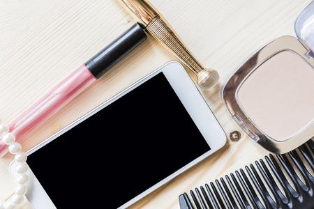 comb: woman mascara. comb and phone Stock Photo
