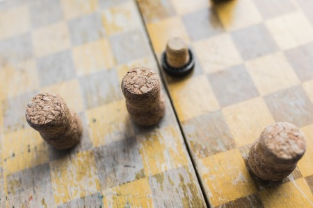 checkers game with wine stoppers