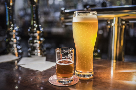 Beer glasses with beer on the bar 4 Stock Photo