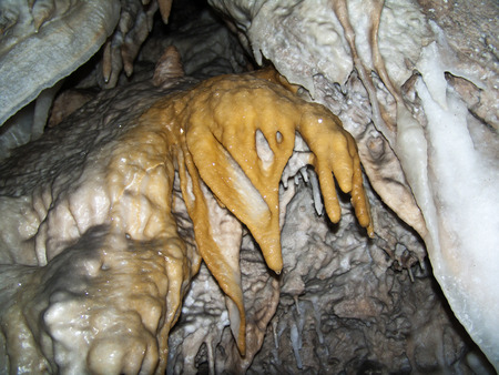 stalagmites: Stalactites, stalagmites, flowstone and other formations in a cave. France