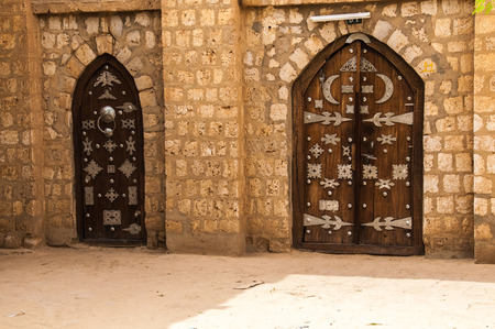 view of a wooden doorway: Gates of the Islamic University of Sankore, Timbuktu, Mali.