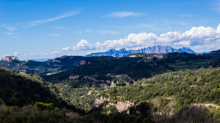 massif: Sierra del Obac with the massif of Montserrat in the background, Barcelona, Catalonia, Spain. Stock Photo