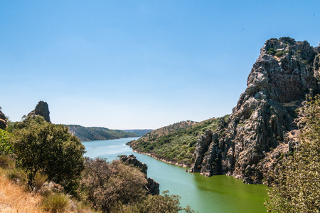extremadura: Cliff called jumping gypsy over the Tajo river in Monfrague National Park, Extremadura, Spain.