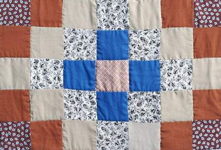 on lap: Handmade patchwork quilt