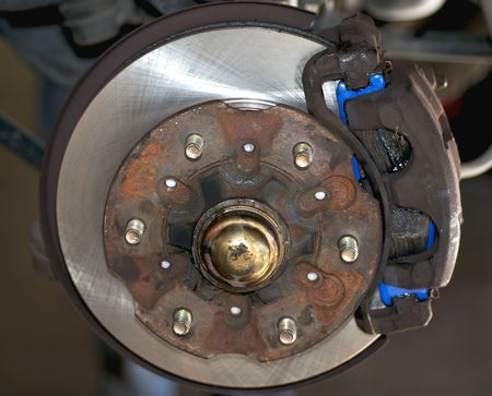 repaired: Image of repaired disk brakes. New brake pad and new brake rotor. Stock Photo