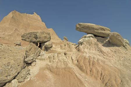 stratification: Wide-angle view of balanced rocks at The Badlands National Park in South Dakota. Best viewed at normal size. Stock Photo