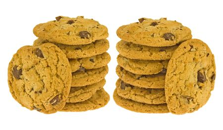 Image of stacks of chocolate pecan cookies isolated on white back ground.