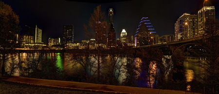unidentifiable: Skyline of Austin, Texas at night.  Recognizable company names and logos have either been removed or blurred.  All people in image are unidentifiable. Stock Photo