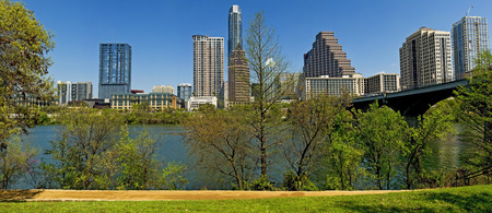 Skyline of Austin, Texas.  Recognizable company names and logos have either been removed or blurred.  All people in image are unidentifiable. Stock Photo