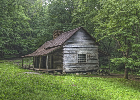 log cabin: Noah Bud Ogle log cabin located in the Roaring Fork Area of the Great Smoky Mountains National Park, Tennessee.  Public Property no Property Release required. Stock Photo
