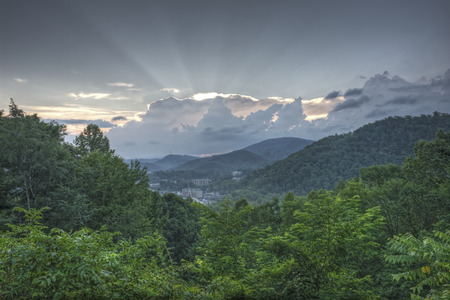 great smokies: Cloudy summer morning sunrise over Gatlinburg, Tennessee.  Image taken from Gatlinburg bypass overlook.