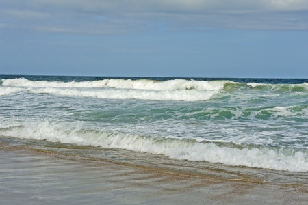Beach, waves, and sand of the Atlantic Ocean at the Outer Banks of North Carolina.