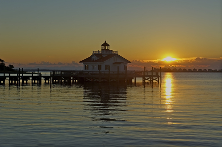 obx: Roanoke Marshes Lighthouse in Manteo, North Carolina, at Sunrise. Stock Photo