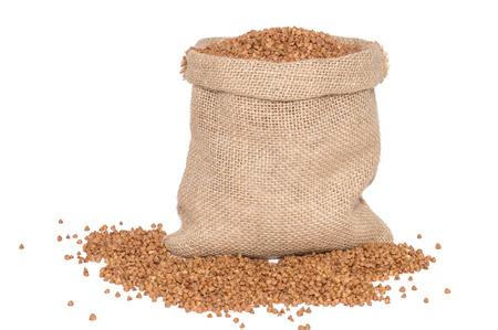 Buckwheat in sack bag  isolated on white background