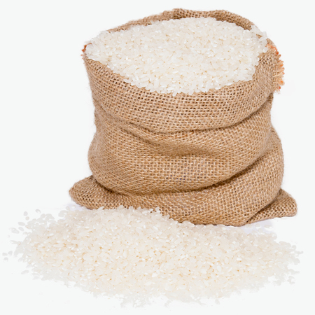 White rice in burlap sack bag isolated on white background