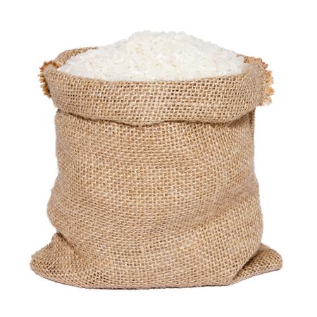 White rice in burlap sack bag isolated on white background Imagens - 90332152