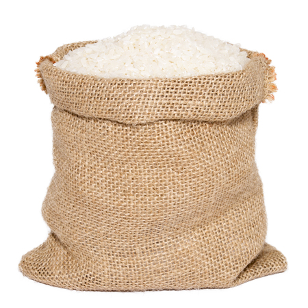 White rice in burlap sack bag isolated on white background